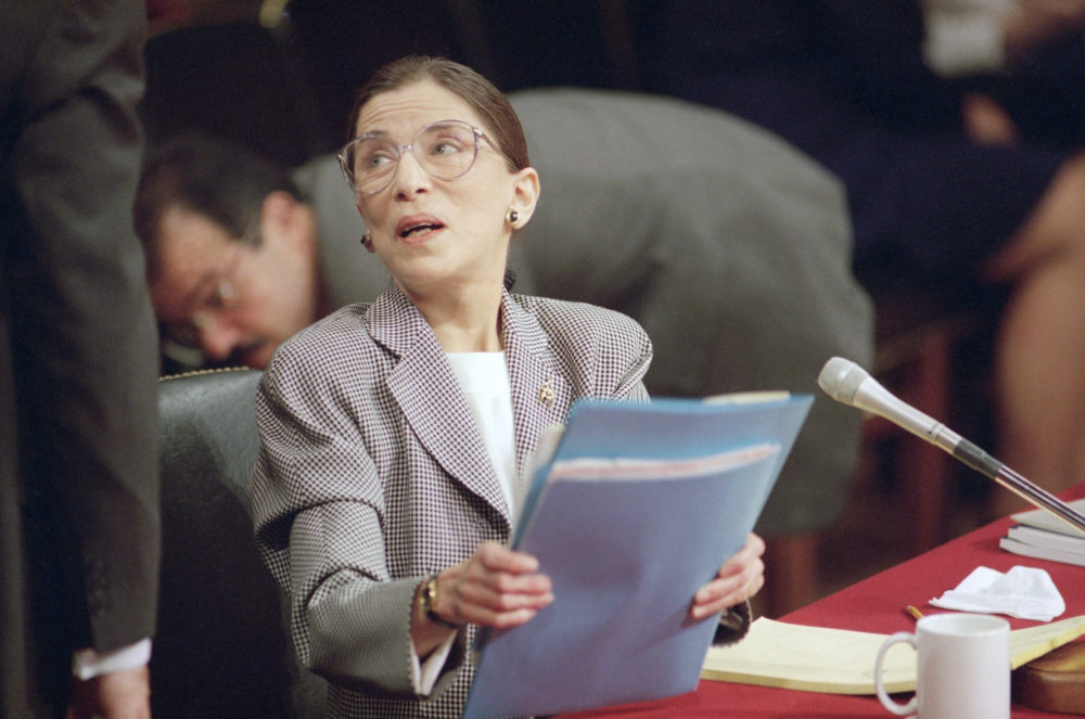 Supreme Court nominee Judge Ruth Bader Ginsburg gathers her papers at the lunch break of her confirmation hearing before the Senate Judiciary Committee on Capitol Hill on Thursday, July 22, 1993 in Washington. (Charles Tasnadi/AP Photo)