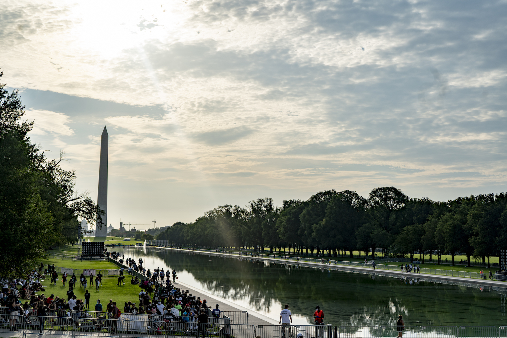 The early morning sun kisses the reflecting pool as lines begin to form for the March on Washington. (OJ Slaughter for WBUR)