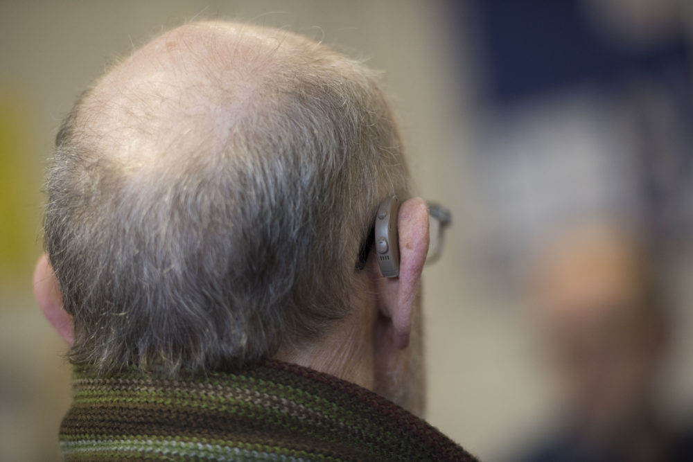 A man wears a hearing aid in this 2015 photo. (Matthew Horwood/Getty Images)