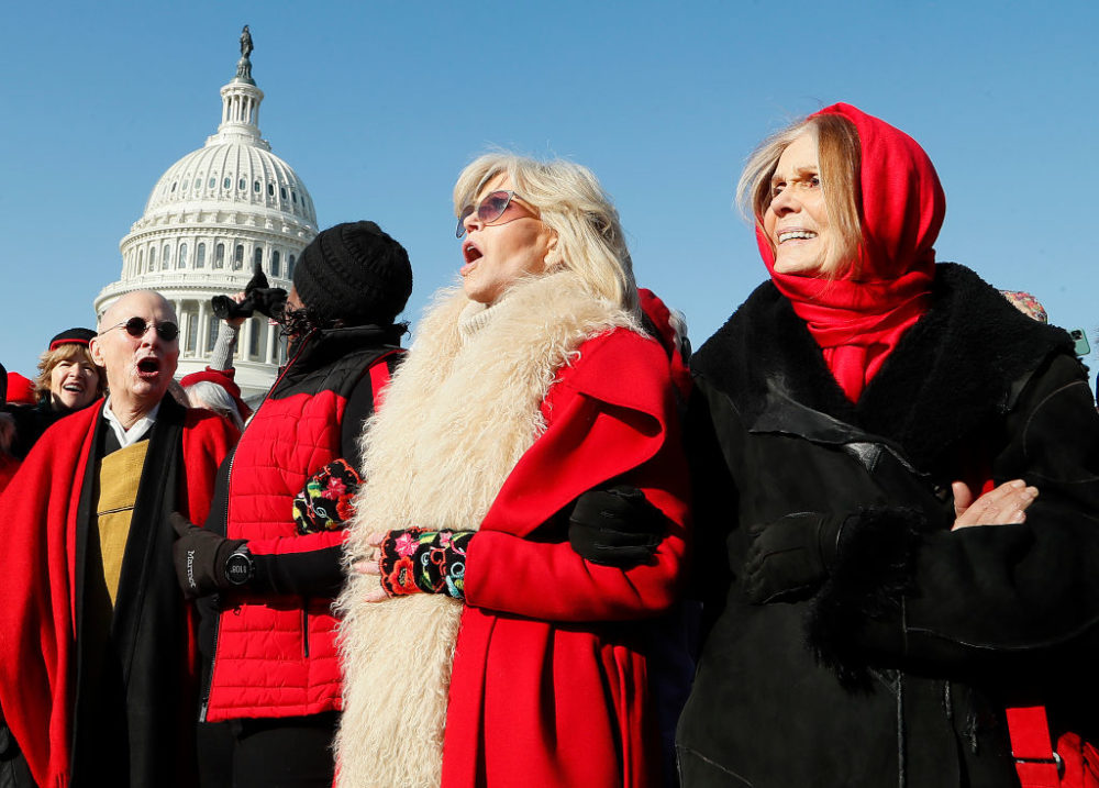 "Actress and activist Jane Fonda (center) and Gloria Steinem (right) march during the ""Fire Drill Fridays"" climate change protest and rally on Capital Hill on December 20, 2019, in Washington, D.C. (Paul Morigi/Getty Images)"