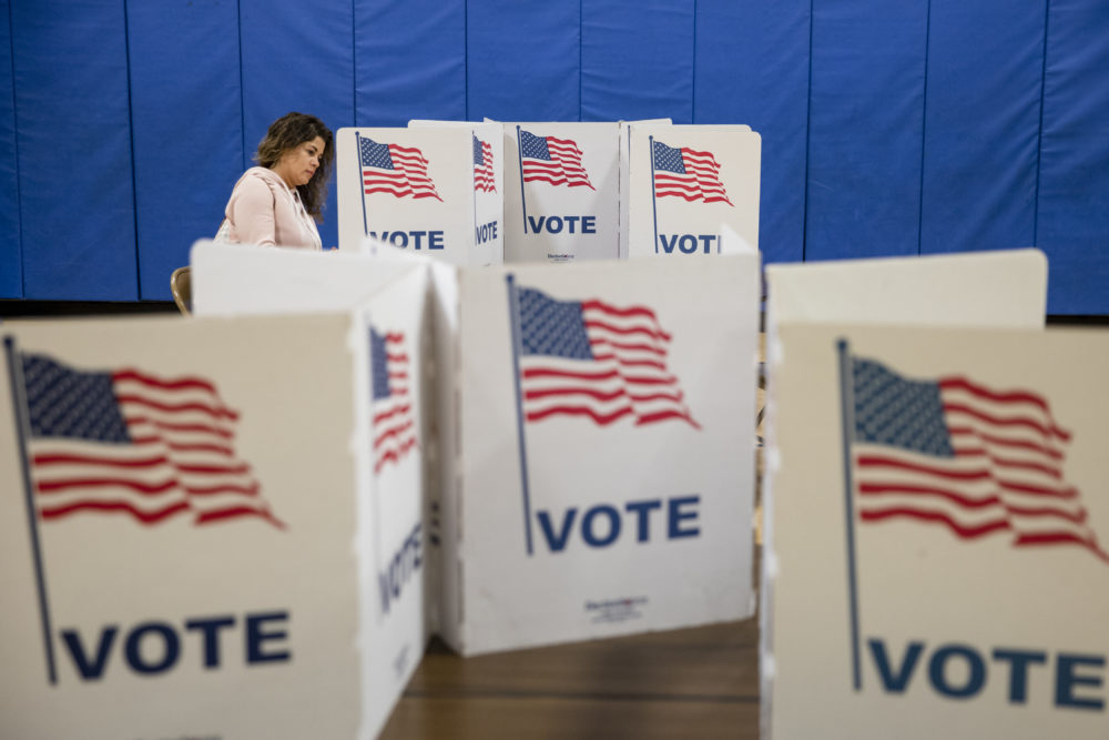 A woman marks down her vote on a ballot for the Democratic presidential primary election at a polling place in Armstrong Elementary School on Super Tuesday, March 3, 2020 in Herndon, Virginia. 1,357 Democratic delegates are at stake as voters cast their ballots in 14 states and American Samoa on what is known as Super Tuesday. (Samuel Corum/Getty Images)