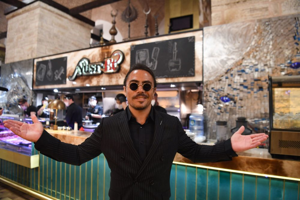 Turkish restaurateur Nusret Gokce, also known as 'Salt Bae', poses for photos at the Istanbul location of his restaurant 'Nusr-Et' at the Grand Bazaar after its reopening on June 1, 2020. (Photo by OZAN KOSE/AFP via Getty Images)