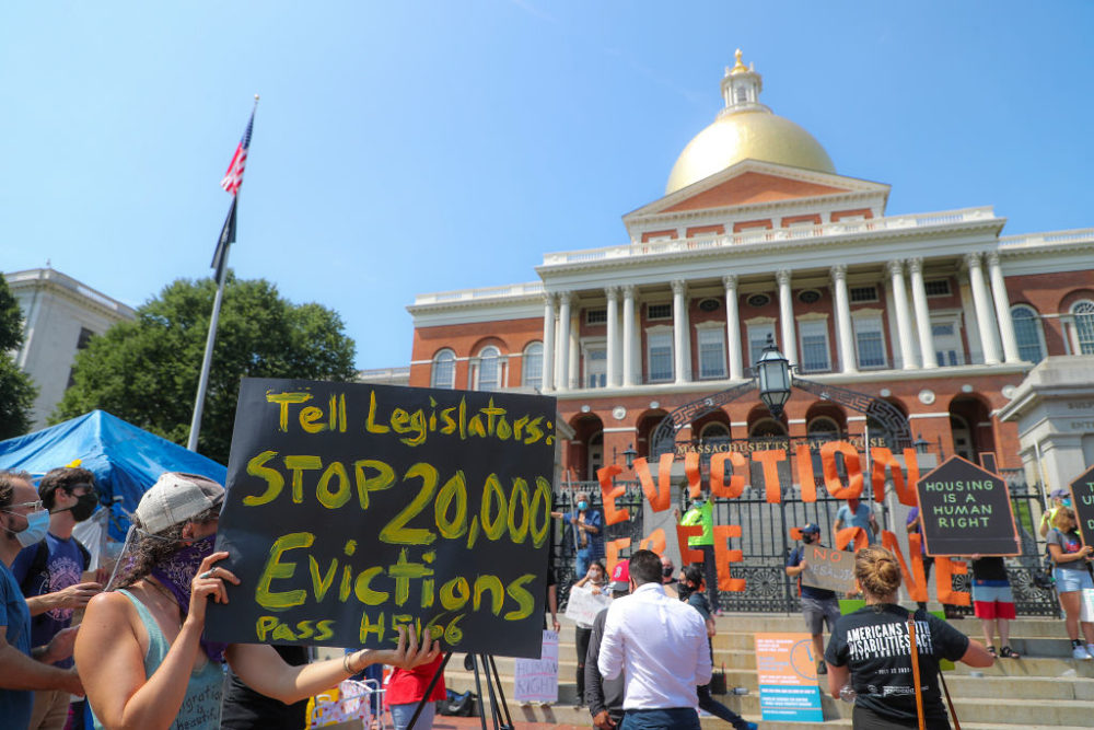 Protesters gather at a rally in support of bills and legislation to block evictions in Massachusetts for up to a year in front of the Massachusetts State House in Boston on July 22, 2020. (Matthew J. Lee/The Boston Globe via Getty Images)