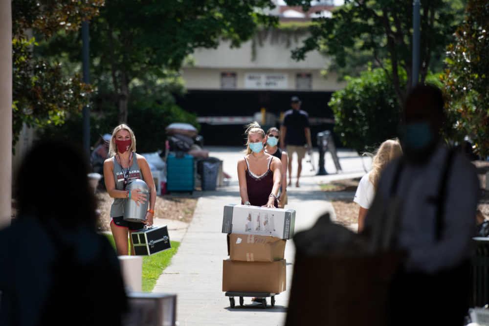 Students move belongings into a campus dormitory at the University of South Carolina on August 10, 2020 in Columbia, South Carolina. (Sean Rayford/Getty Images)