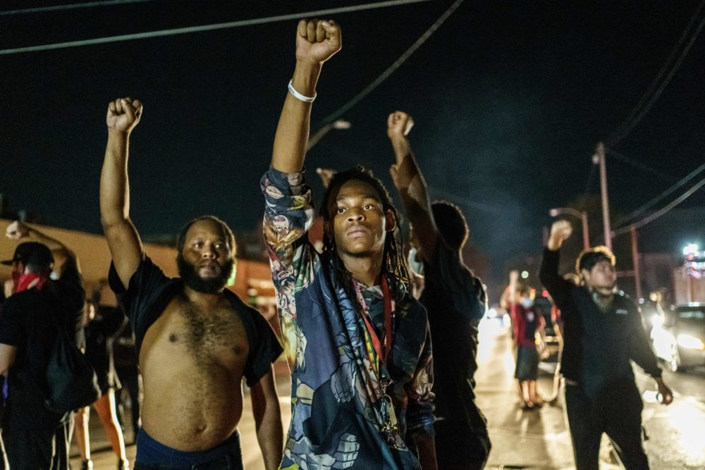 Protesters raise their fists during a demonstration against the shooting of Jacob Blake in Kenosha, Wisconsin on August 26, 2020. (KEREM YUCEL/AFP via Getty Images)