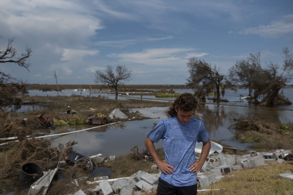 Connor Theriot, 16, has an emotional moment while standing on the slab of foundation that once held his family's home after Hurricane Laura  landed along the Texas-Louisiana border in Cameron, Louisiana on August 30, 2020. (Callaghan OHare/Washington Post via Getty Images)