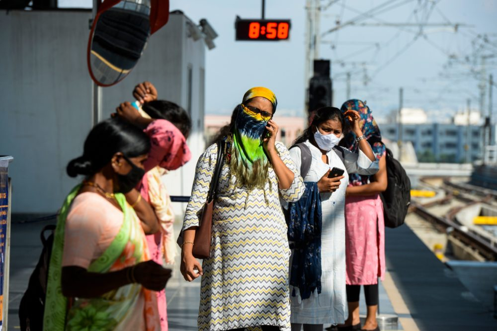 Passengers waits for a train following the resumption of metro services after more than five months of shutdown due to the Covid-19 coronavirus pandemic, at a station in Hyderabad on September 7, 2020.(NOAH SEELAM/AFP via Getty Images)