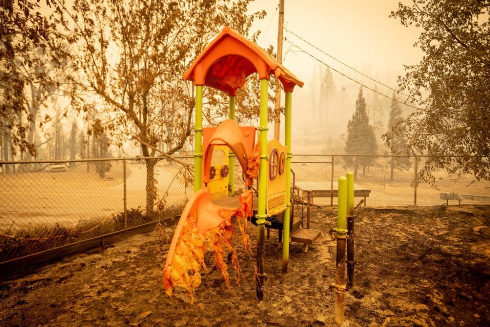 A melted slide smolders as a playground continues to burn during the Creek Fire in California on September 8, 2020. (Josh Edelson/AFP/Getty Images)