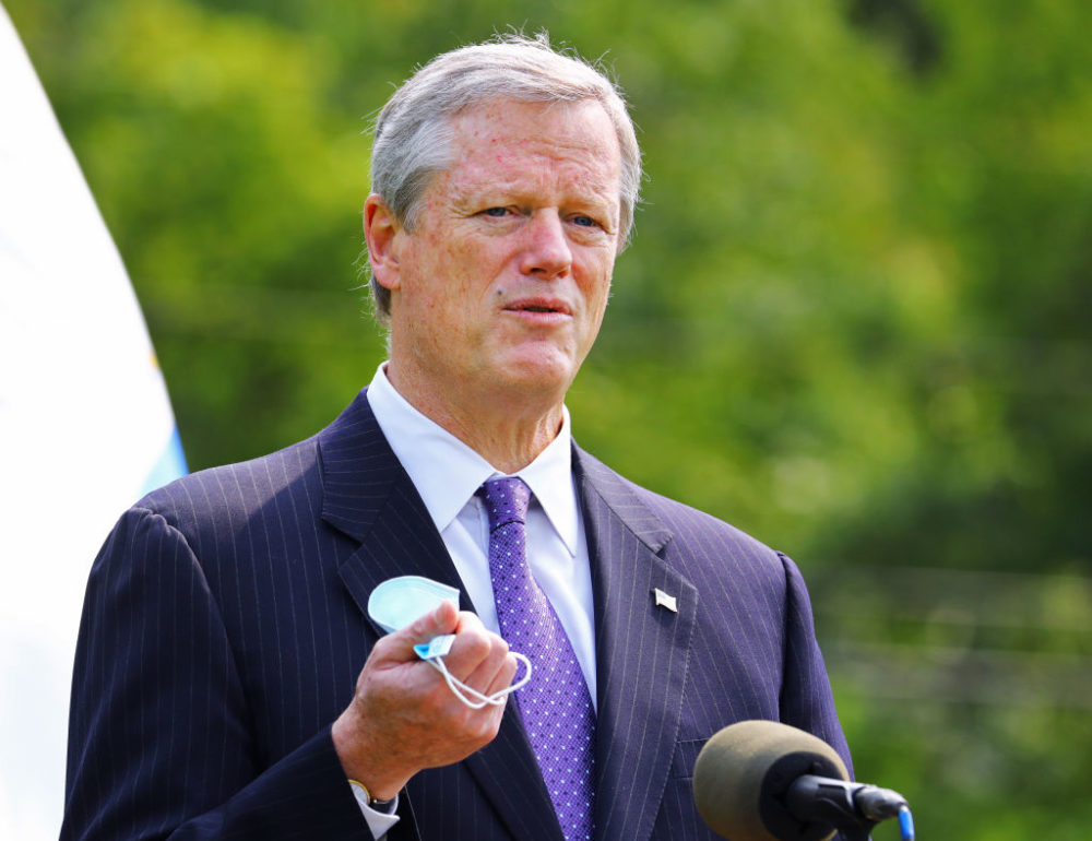 Gov. Charlie Baker points to the effectiveness of wearing face masks during a press conference on Sept. 15, 2020. (Pat Greenhouse/The Boston Globe via Getty Images)