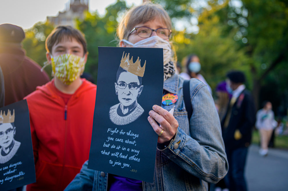 A participant holding a sign at a candle light vigil and memorial for Justice Ruth Bader Ginsburg at  Washington Square Park in New York City on September 19, 2020. (Erik McGregor/LightRocket via Getty Images)