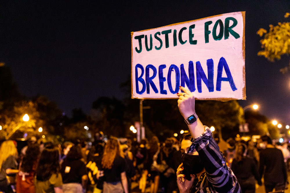 A protester carries a sign in honor of Breonna Taylor on Wednesday in Chicago. (Natasha Moustache/Getty Images)