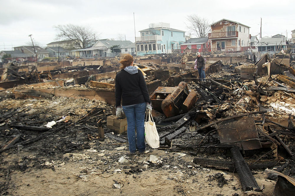 People look through the remains of homes destroyed during Hurricane Sandy October 30, 2012 in the Breezy Point neighborhood of the Queens borough of New York City. (Spencer Platt/Getty Images)