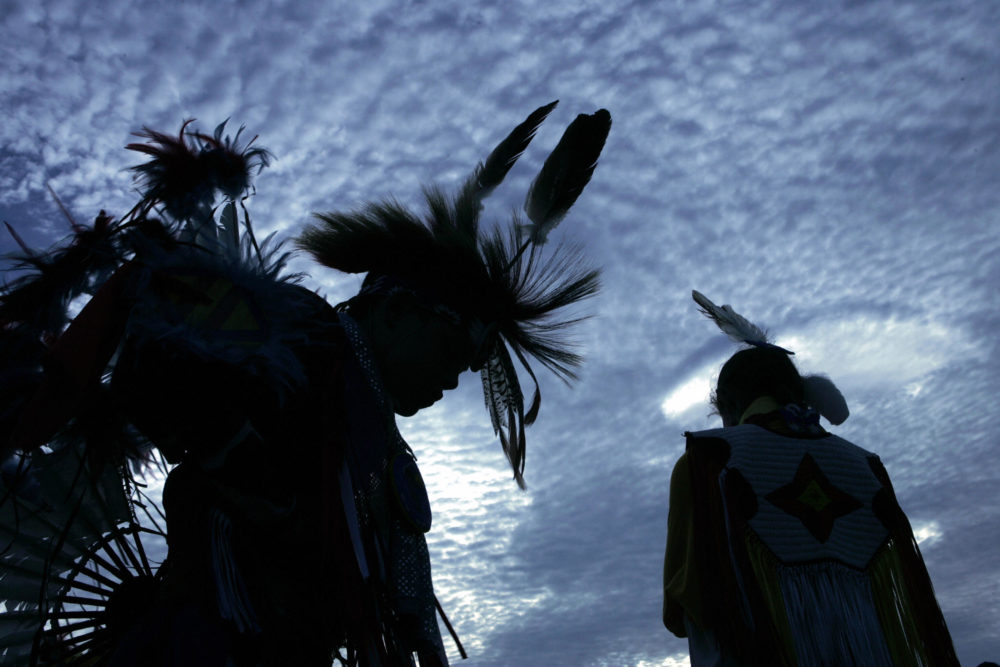 Harrison Revels (L) and his cousin Courtney Baxter, members of the Lumbee Tribe in North Carolina, wait for a tribal dance on the National Mall after the grand opening of the Smithsonian's National Museum of the American Indian in 2004. (Brendan Smialowski/AFP/Getty Images)