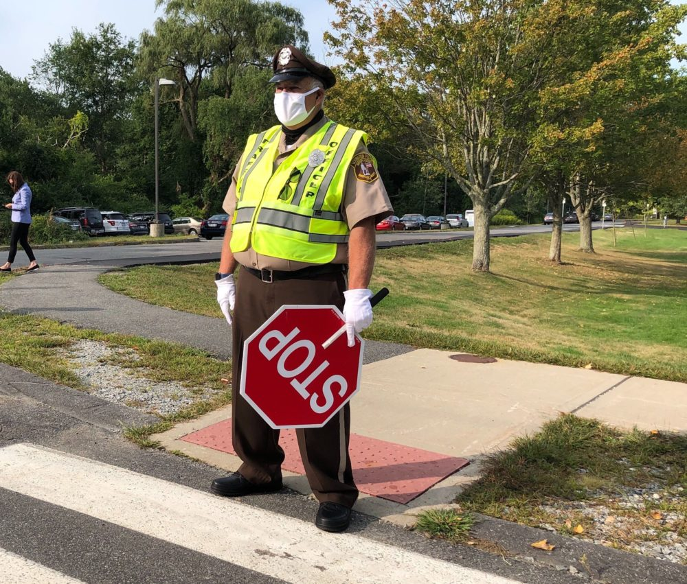 Crossing Guard David Hadley helps kindergarten students and their families across Philip Road.