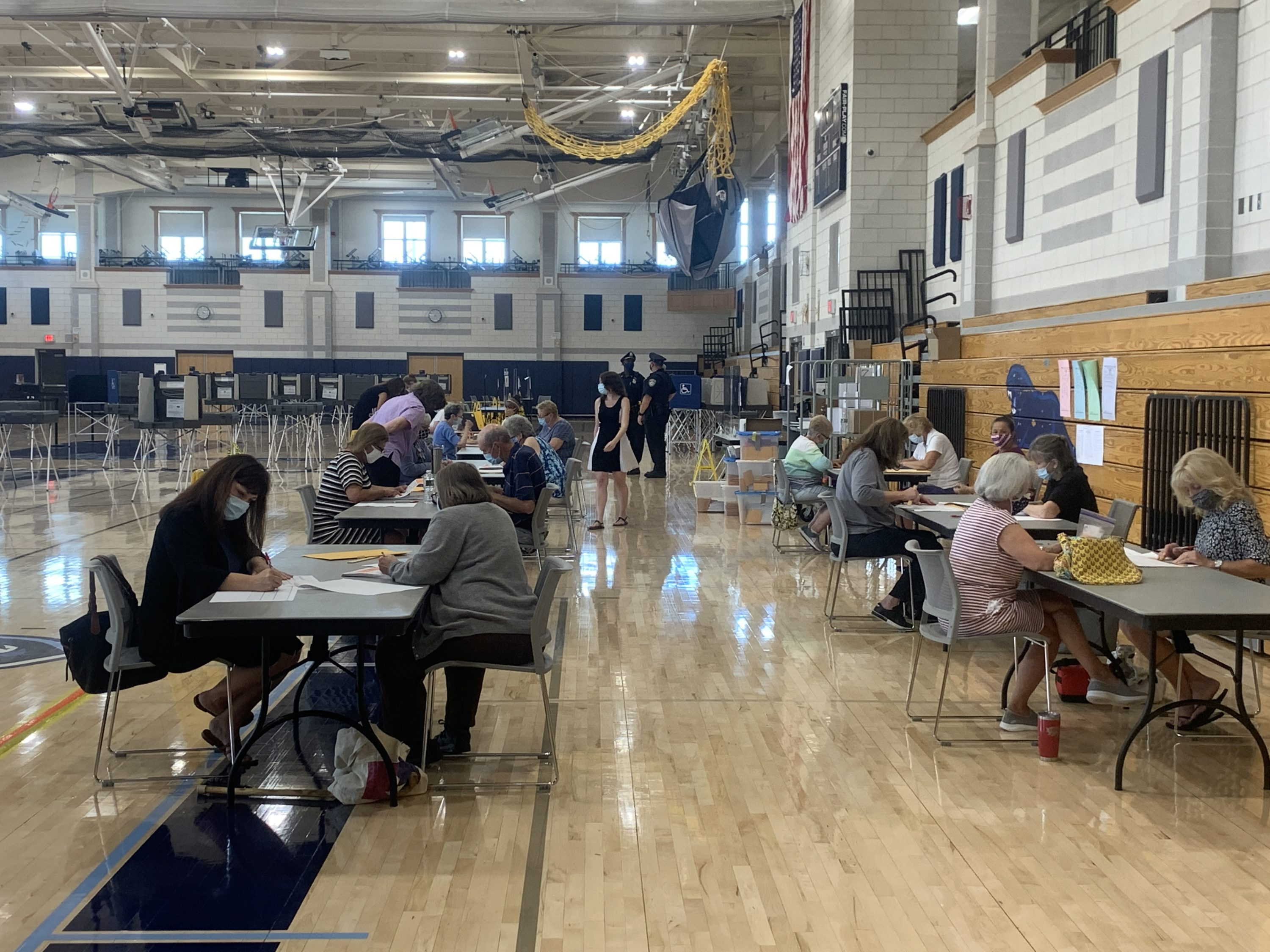 Election workers and staffers from the Secretary of State's office continue to count votes in Franklin, where roughly 3,000 uncounted ballots were discovered two days after Tuesday's primary. (Simón Rios/WBUR)