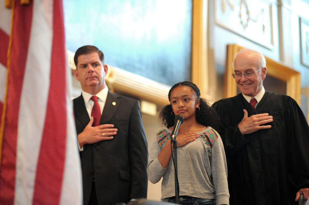 Mayor Martin Walsh and U.S. District Judge Nathaniel Gorton join Soley Guerrero in the Pledge of Allegience during a U.S. Naturalization ceremony July 10, 2014 at Faneuil Hall. (Don Harney/City of Boston)