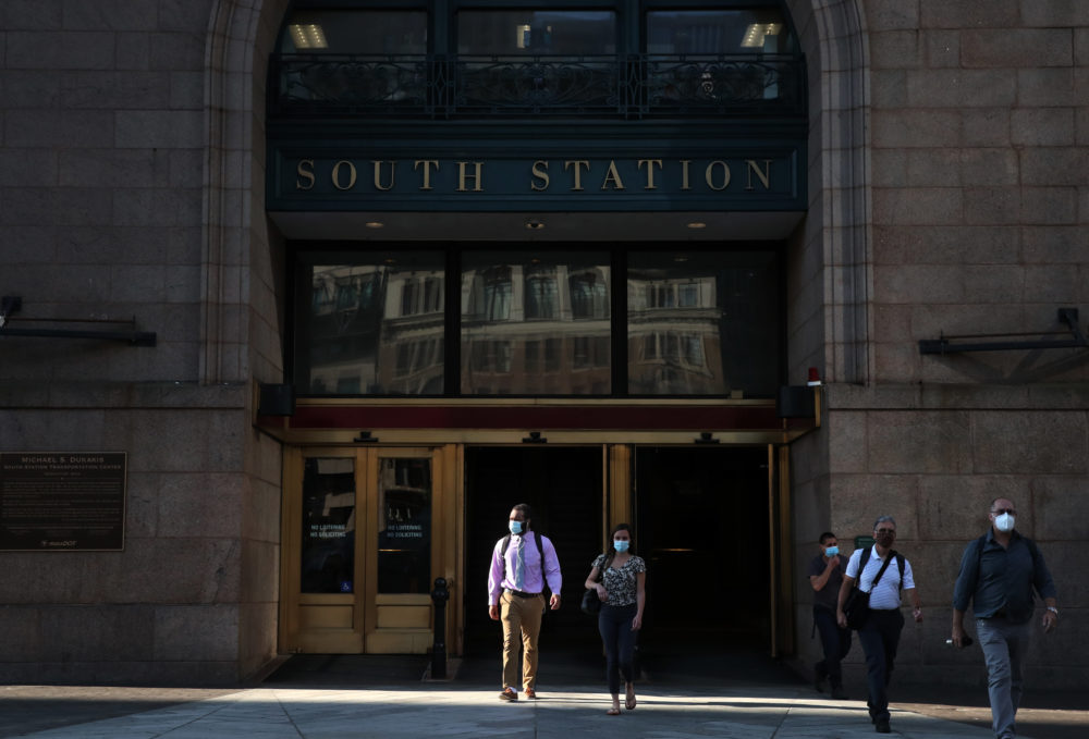 Commuters depart South Station in Boston, MA on July 14, 2020. (Photo by Craig F. Walker/The Boston Globe via Getty Images)