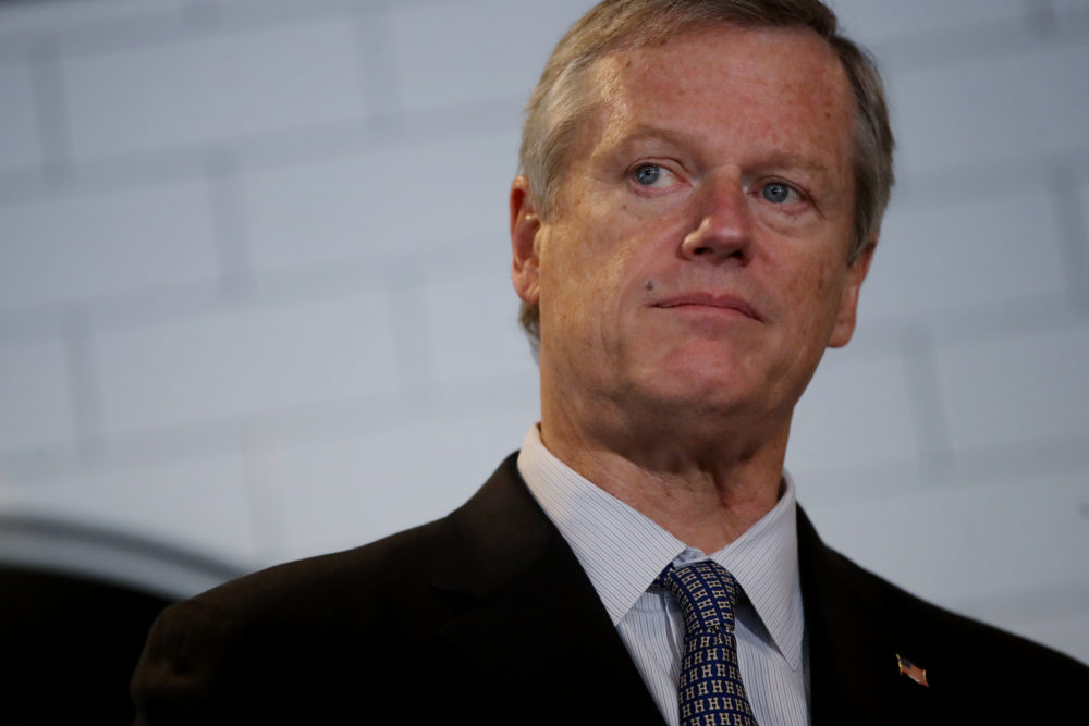 Gov. Charlie Baker takes questions from the media at Mill City BBQ and Brew in Lowell, Mass. on Sept. 23, 2020. (Craig F. Walker/Globe Staff via pool)