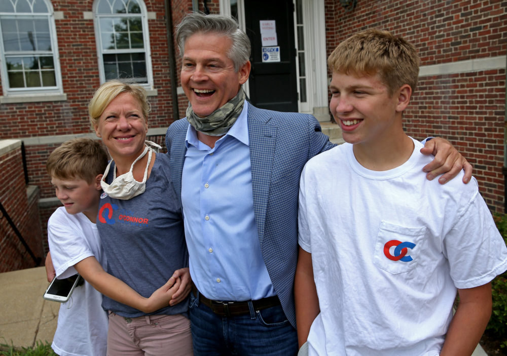 Kevin O'Connor who's running for U.S. Senate as the Republican with his family, Matt, 13, Kyle, 9, and his wife, Janet, at the Dover Town Hall after casting his vote on Aug. 26, 2020. (Matt Stone/ MediaNews Group/Boston Herald via GettyImages)