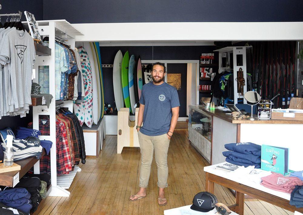 Walle Hutton, owner of Rhode Island Surf Co., at his shop in downtown Westerly. (Alex Nunes/The Public's Radio)