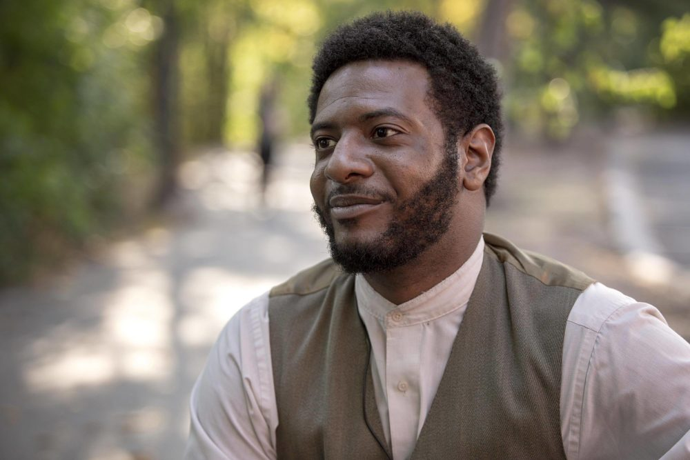 "Actor Kadahj Bennett, who performs all the characters in ""The Charles W. Lenox Experience."" (Robin Lubbock/WBUR)"