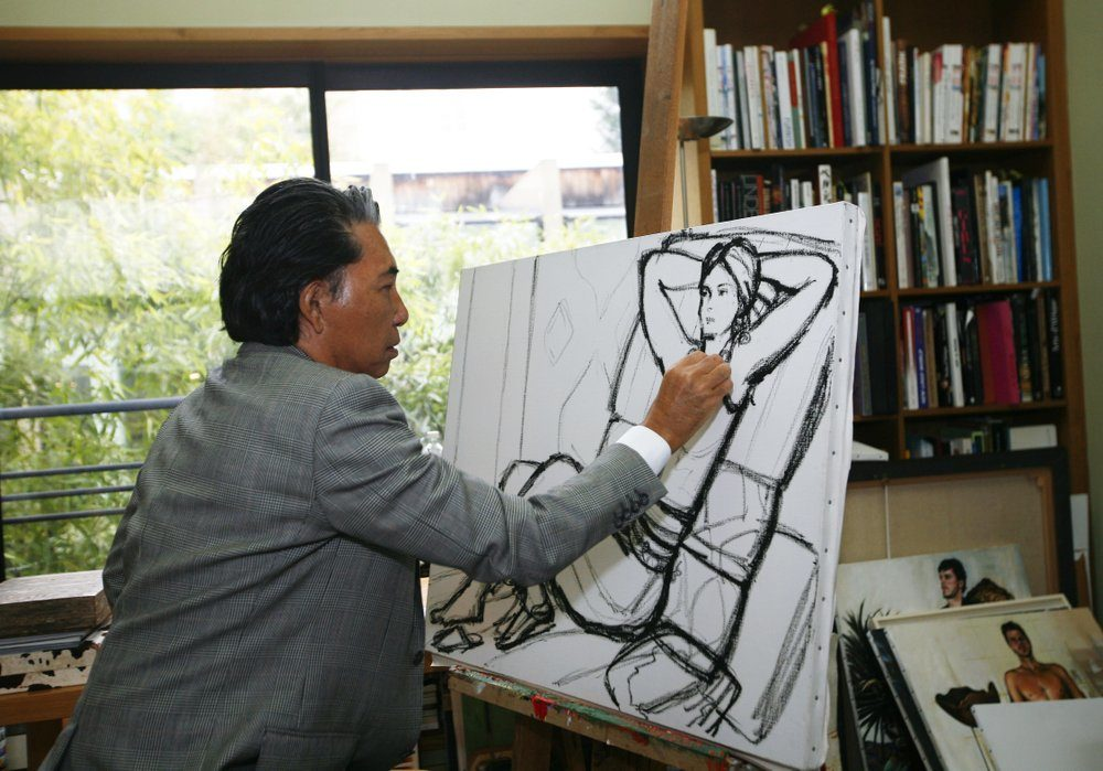 In this Tuesday, March 24, 2009 file photo, Japanese fashion designer Kenzo Takada sketches in his Paris house. Fashion designer Kenzo Takada dies from COVID-19 complications at age 81 near Paris, spokeswoman and reports said Sunday Oct. 4, 2020. (Jacques Brinon/AP)