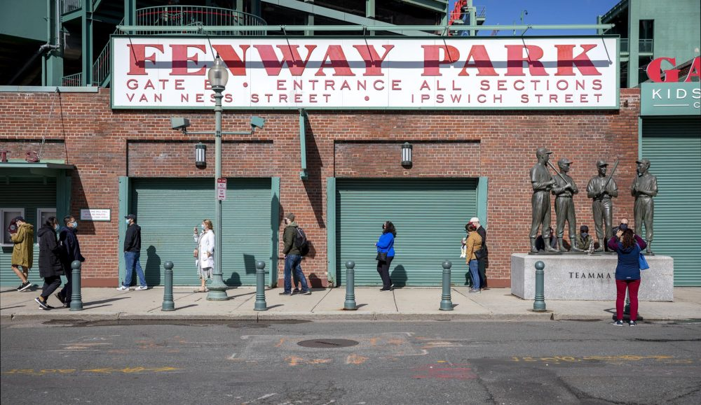 Early voters line up to cast their ballots outside of Fenway Park on Saturday, Oct. 17 in Boston. (Robin Lubbock/WBUR)