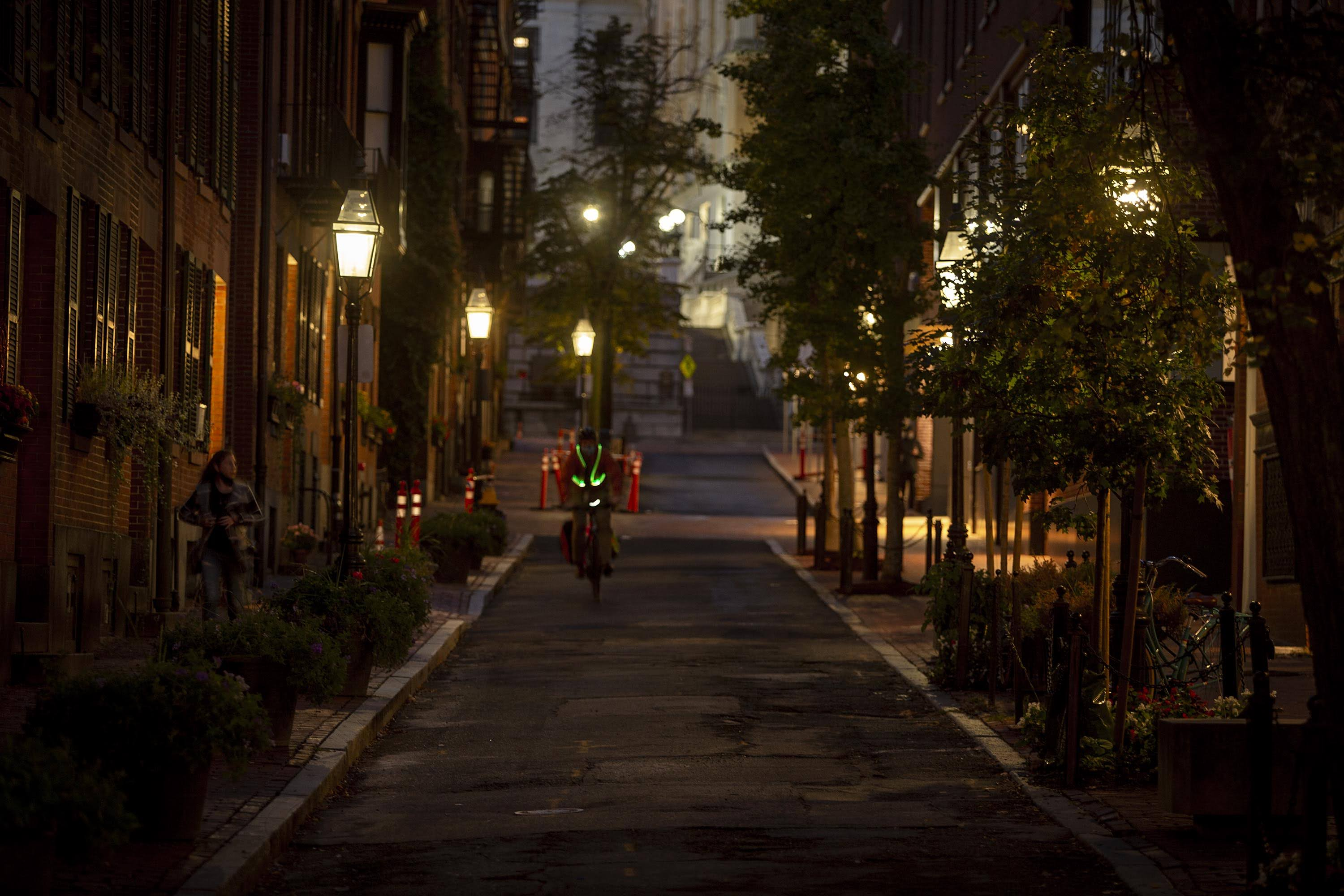 Gas lamps illuminate Temple Street in Boston's Beacon Hill on a fall evening. (Robin Lubbock/WBUR)