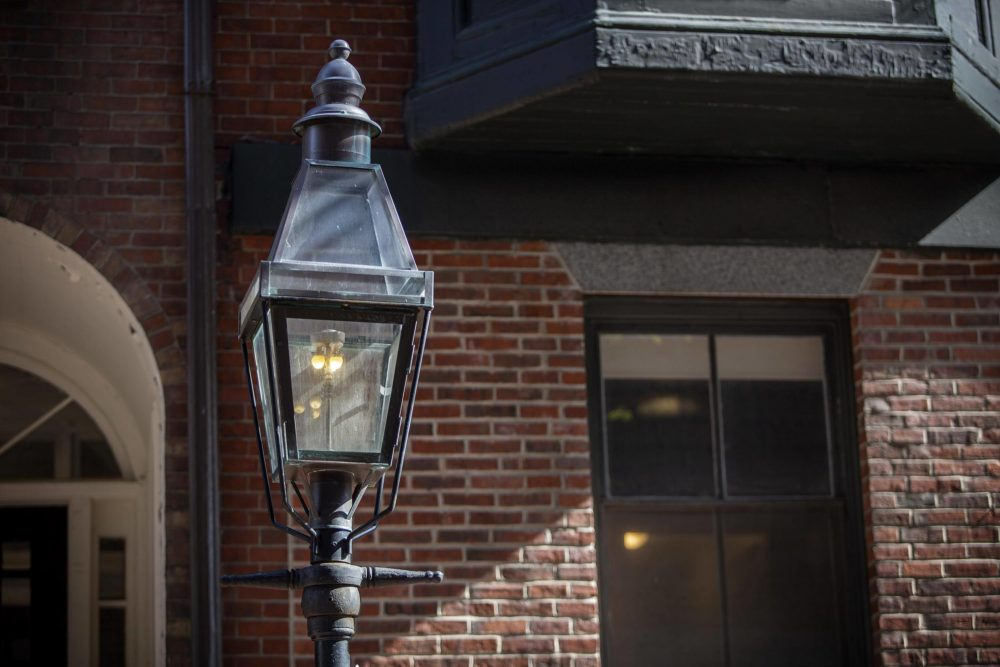 A gas lamp burning on Temple Street in the middle of the day. The lamps remain lit 24 hours a day. (Robin Lubbock/WBUR)