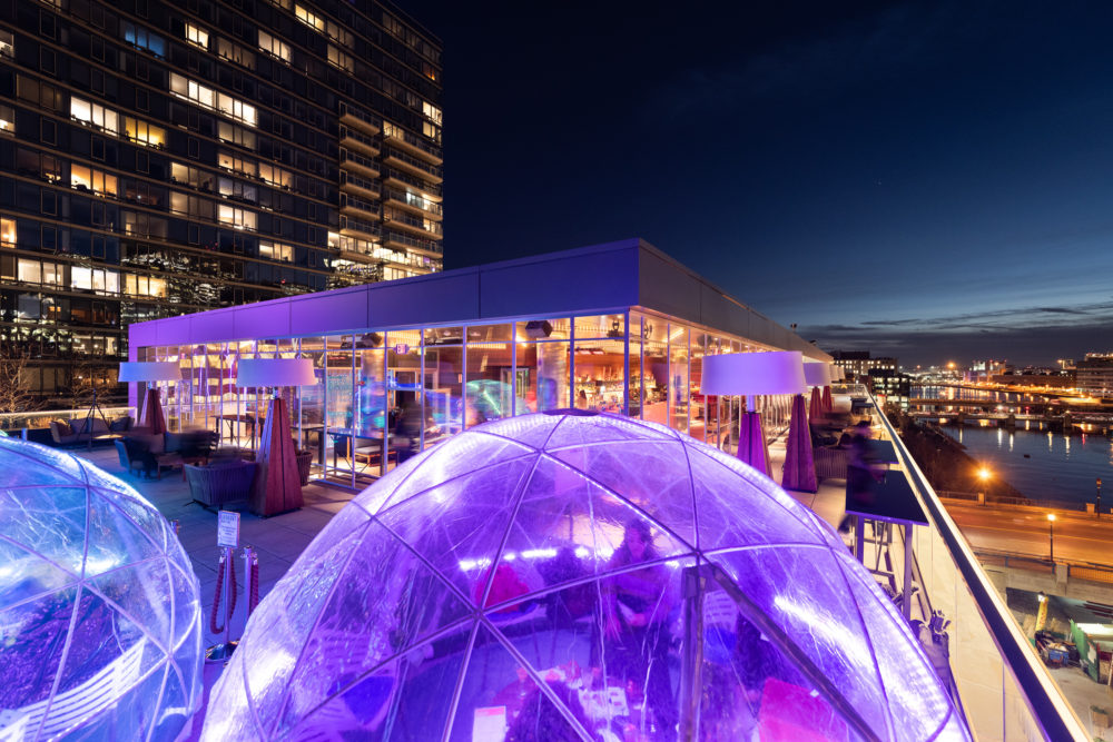 Diners enjoying a meal inside igloos at Boston's Envoy Hotel. (Courtesy)