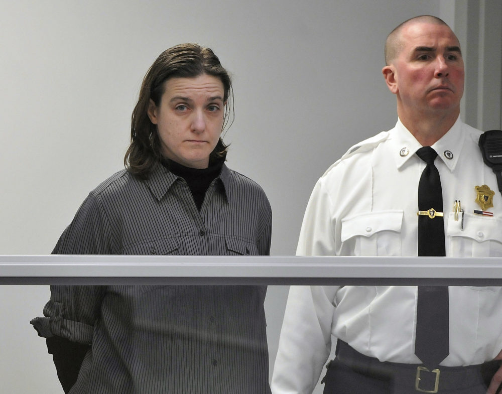 In this Jan. 22, 2013, file photo, Sonja Farak, left, stands during her arraignment at Eastern Hampshire District Court in Belchertown, Mass. (Don Treeger/The Republican via AP, Pool, File)