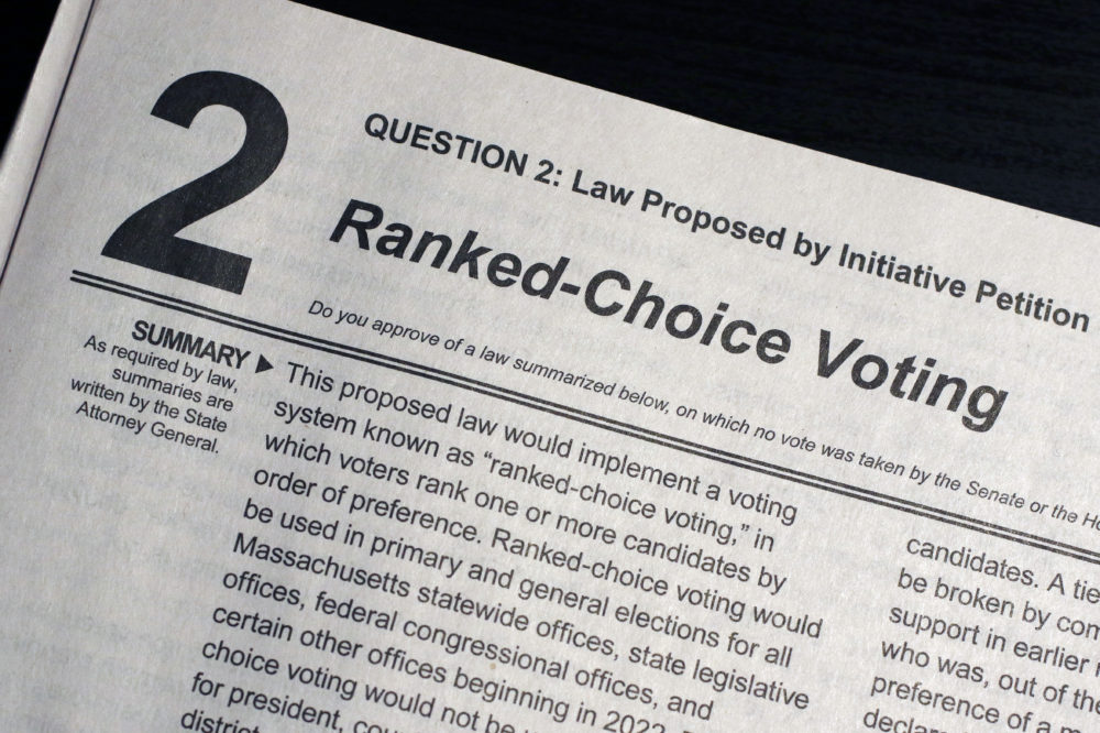 "A summary of Ballot Question 2, known as a ""Ranked-Choice Voting"" law, in the Nov. 3, 2020, Massachusetts election is displayed in a handbook provided to voters by the Secretary of the Commonwealth, Wednesday, Sept. 23, 2020 in Marlborough, Mass. (Bill Sikes/AP)"
