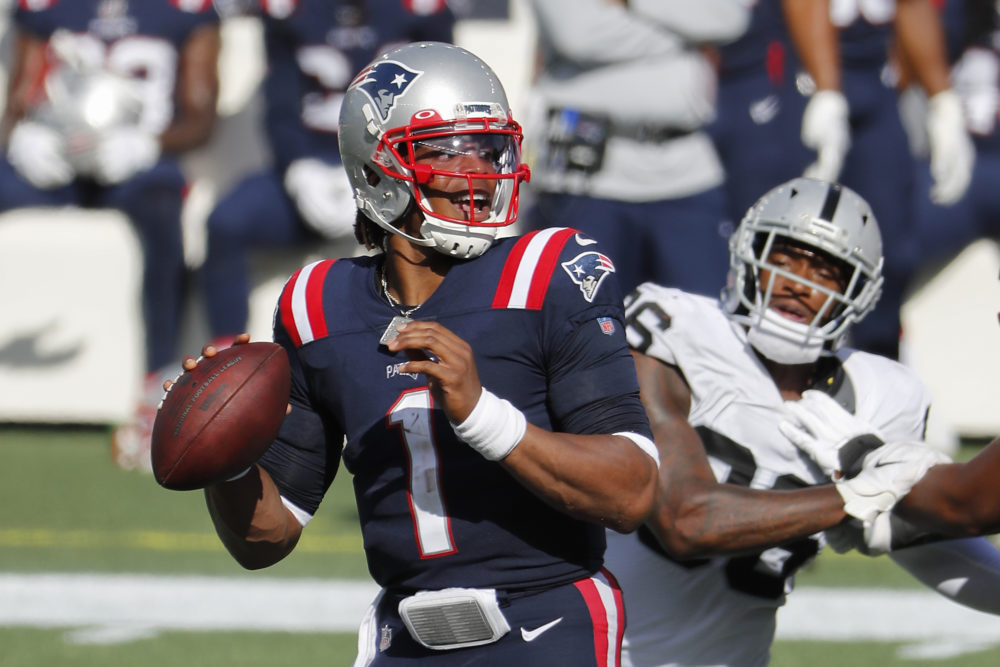 New England Patriots quarterback Cam Newton looks to pass against the Las Vegas Raiders during an NFL football game at Gillette Stadium, Sunday, Sept. 27, 2020 in Foxborough, Mass. (Winslow Townson/AP)