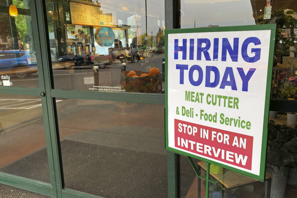 "A sign that reads ""hiring today,"" is shown at a grocery store in Olympia, Wash., advertising a job opportunity for a meat cutter on Oct. 3, 2020.   (Ted S. Warren/AP)"