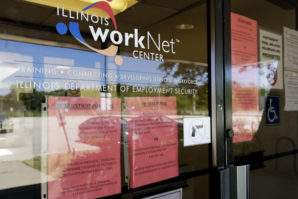 In this June 11, 2020, file photo, information signs are displayed at the closed Illinois Department of Employment Security WorkNet center in Arlington Heights, Ill. U.S. employers advertised for slightly fewer jobs in August while their hiring ticked up modestly. (Nam Y. Huh/AP File)