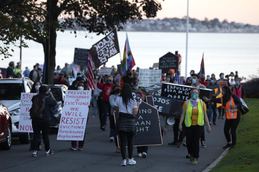 Housing activists march to Gov. Charlie Baker's house, Wednesday, Oct. 14, 2020, in Swampscott, Mass. The protesters were calling on the governor to support more robust protections against evictions and foreclosures during the ongoing coronavirus pandemic. (Michael Dwyer/AP)