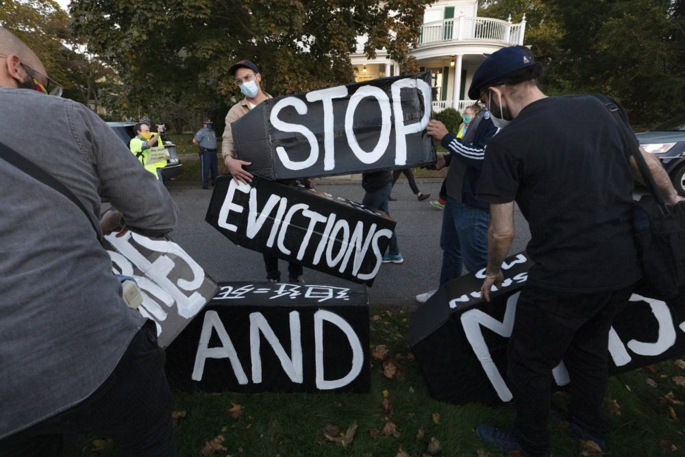 Housing activists erect a sign in front of Gov. Charlie Baker's house, Oct. 14, 2020, in Swampscott, Mass. (Michael Dwyer/AP)