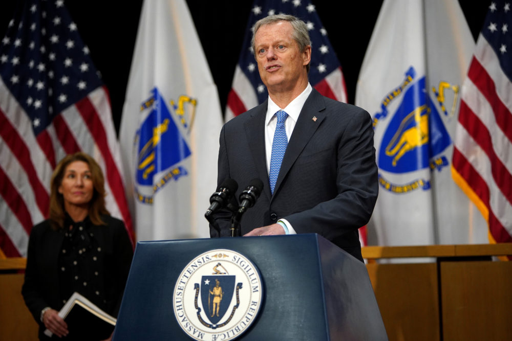 Gov. Baker speaks with Lt. Gov. Karyn Polito at the State House on June 30, 2020. (Barry Chin/The Boston Globe via Getty Images)