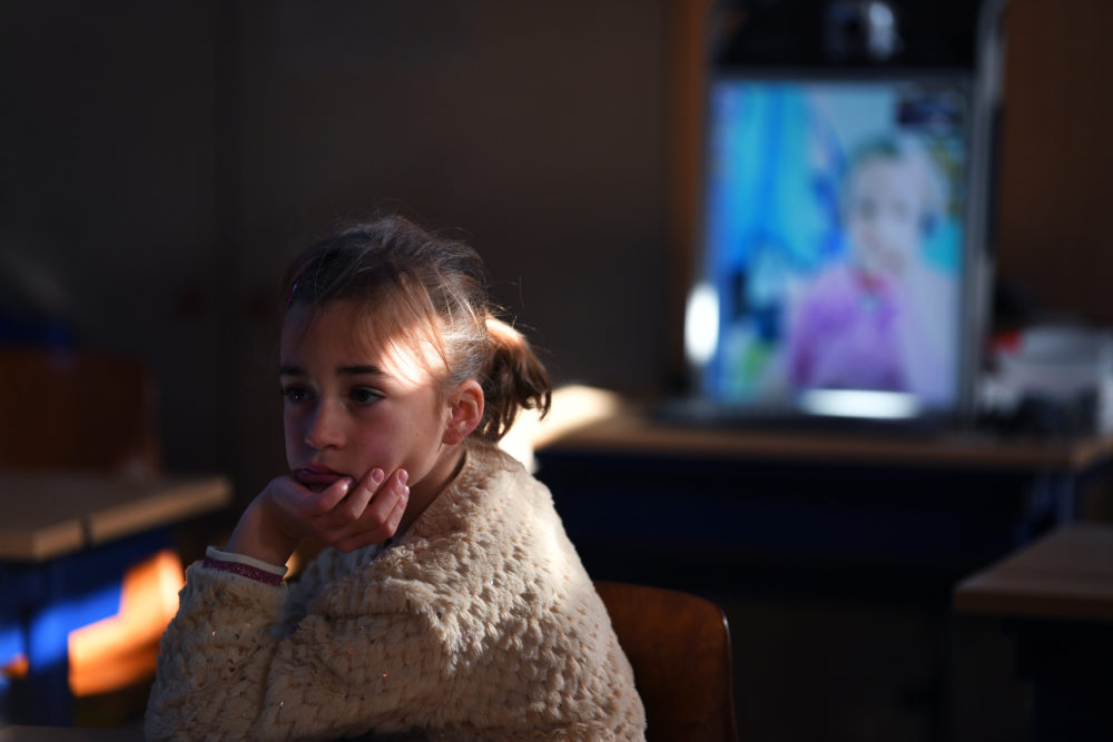 An elementary student following online lessons from home on May 15, 2020 in Sint-Marten-Latem, Belgium. (Tim de Waele/Getty Images)