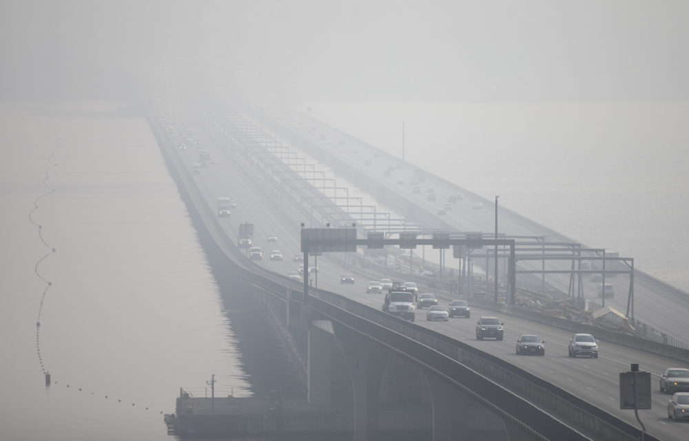 The I-90 bridge over Lake Washington disappears through heavy smoke from wildfires on Sept. 11, 2020 in Seattle, Washington. (Lindsey Wasson/Getty Images)