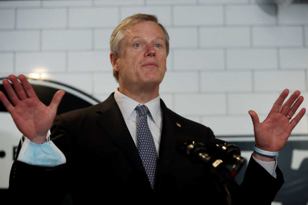 Gov. Charlie Baker takes questions from the media at Mill City BBQ and Brew in Lowell, Sept. 23, 2020. (Craig F. Walker/The Boston Globe via Getty Images)