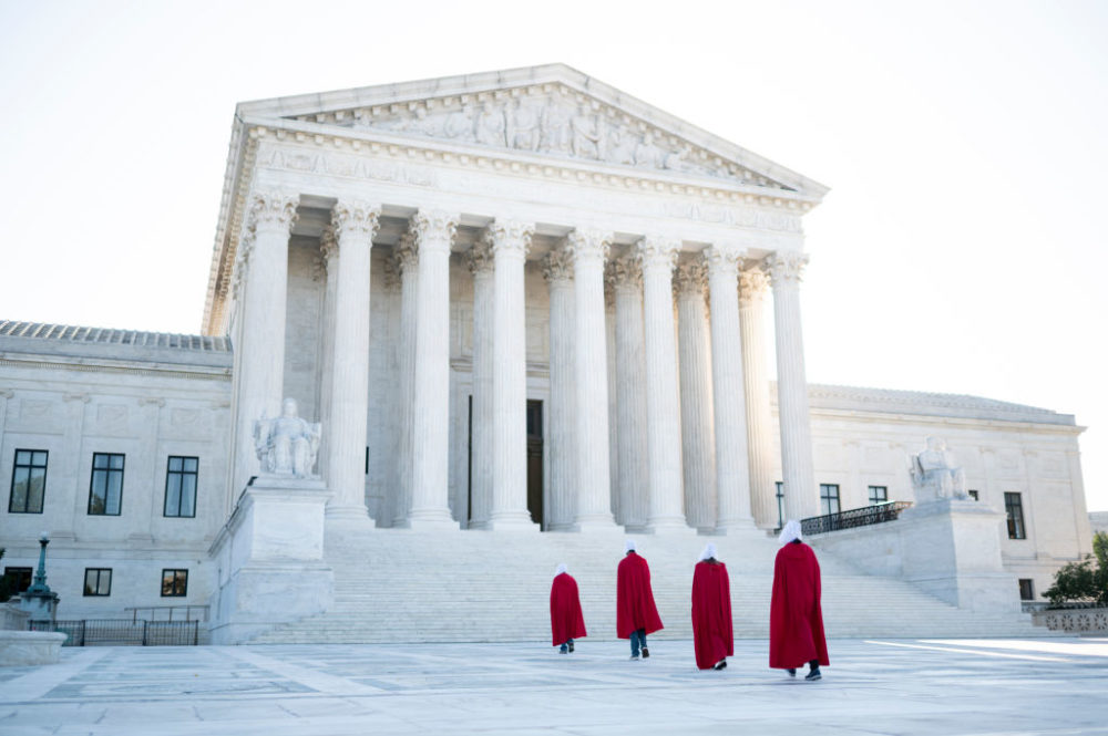 Protesters from the Center for Popular Democracy Action, dressed in Handmaid's Tale costumes, walk across the plaza of the U.S. Supreme Court in Washington on Wednesday, Sept. 30, 2020, to voice opposition to Judge Amy Coney Barrett's nomination to the Supreme Court (Bill Clark/CQ-Roll Call, Inc via Getty Images)