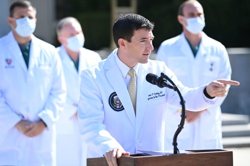 White House physician Sean Conley answers questions surrounded by other doctors, during an update on the condition of US President Donald Trump, on October 4, 2020, at Walter Reed Medical Center in Bethesda, Maryland. (Photo by BRENDAN SMIALOWSKI/AFP via Getty Images)