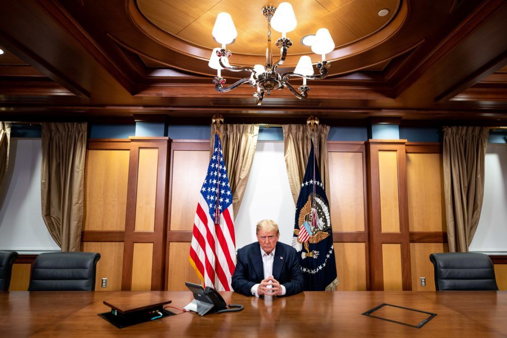 In this handout provided by The White House, President Trump participates in a phone call at Walter Reed National Military Medical Center on Oct. 4, 2020. (Tia Dufour/The White House via Getty Images)