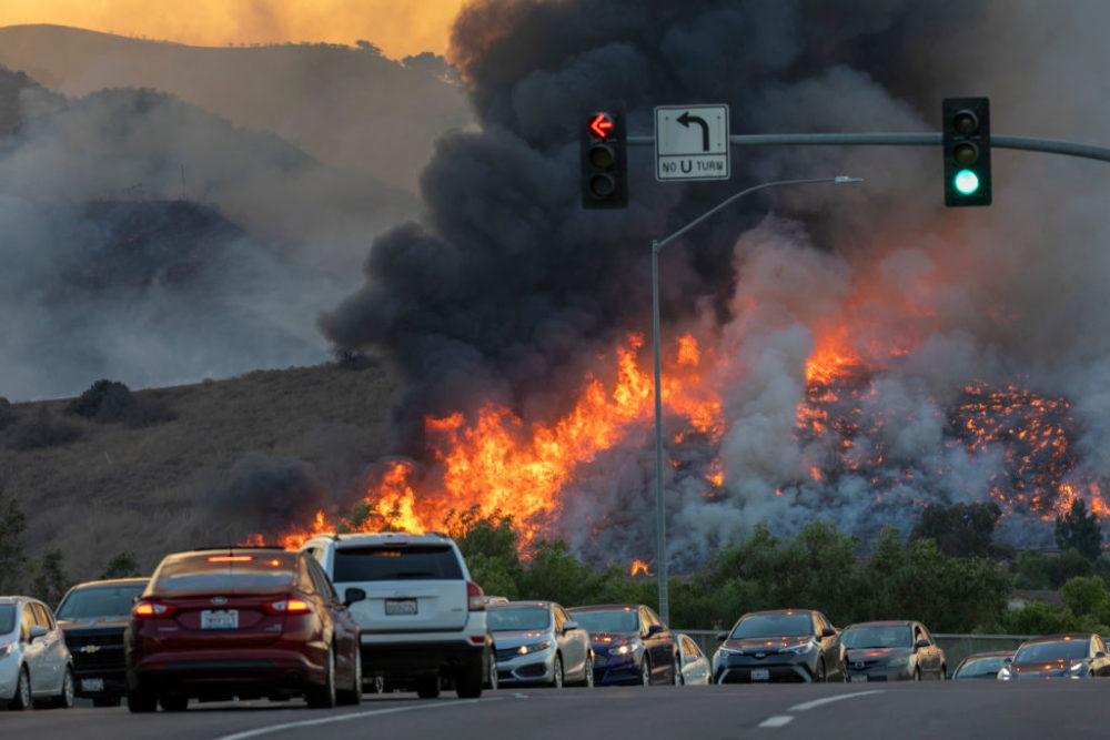 Traffic is diverted off of the 71 freeway during the Blue Ridge Fire on October 27, 2020 in Chino Hills, California. (David McNew/Getty Images)