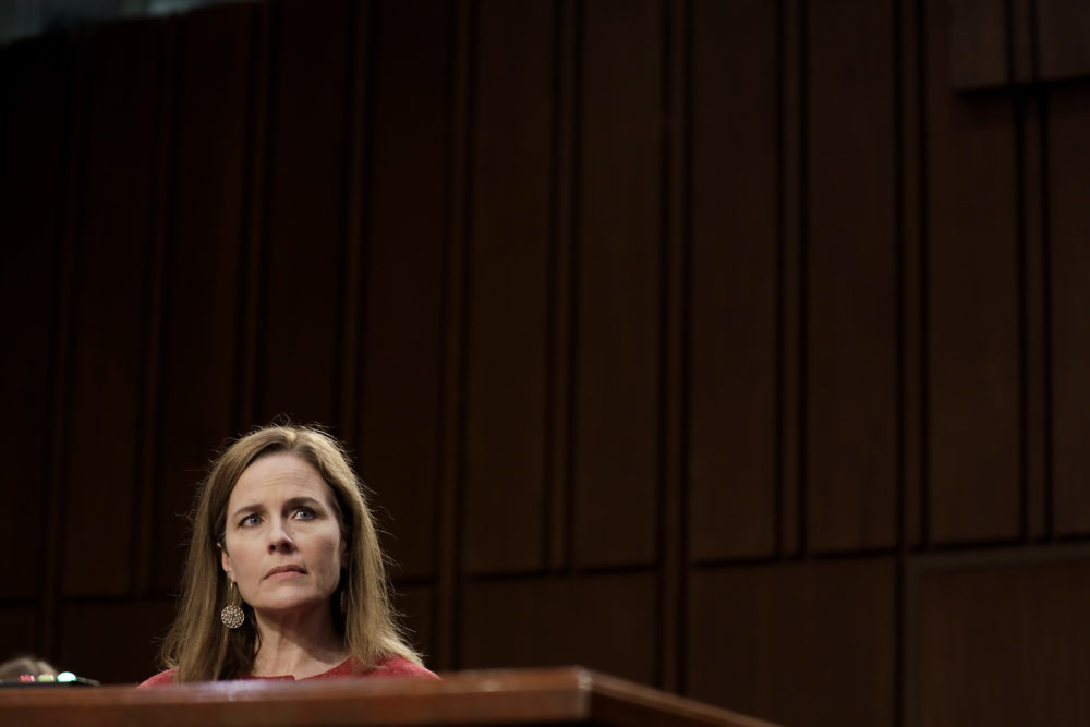 Supreme Court nominee Judge Amy Coney Barrett arrives to testify before the Senate Judiciary Committee on the second day of her Supreme Court confirmation hearing on Capitol Hill on October 13, 2020 in Washington, DC. Barrett was nominated by President Donald Trump to fill the vacancy left by Justice Ruth Bader Ginsburg who passed away in September. (Samuel Corum/Getty Images)