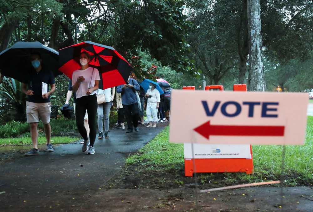 Voters wait in line to cast their early ballots at the Coral Gables Branch Library precinct on October 19, 2020 in Coral Gables, Florida. (Joe Raedle/Getty Images)