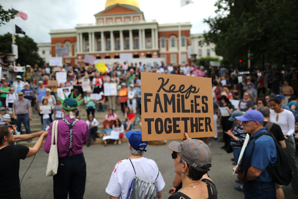 Demonstrators gather outside the Massachusetts State House in Boston to protest the Trump administration policy of separating children from their parents when they arrive at the U.S. border without authorization on June 14, 2018. (John Tlumacki/The Boston Globe via Getty Images)