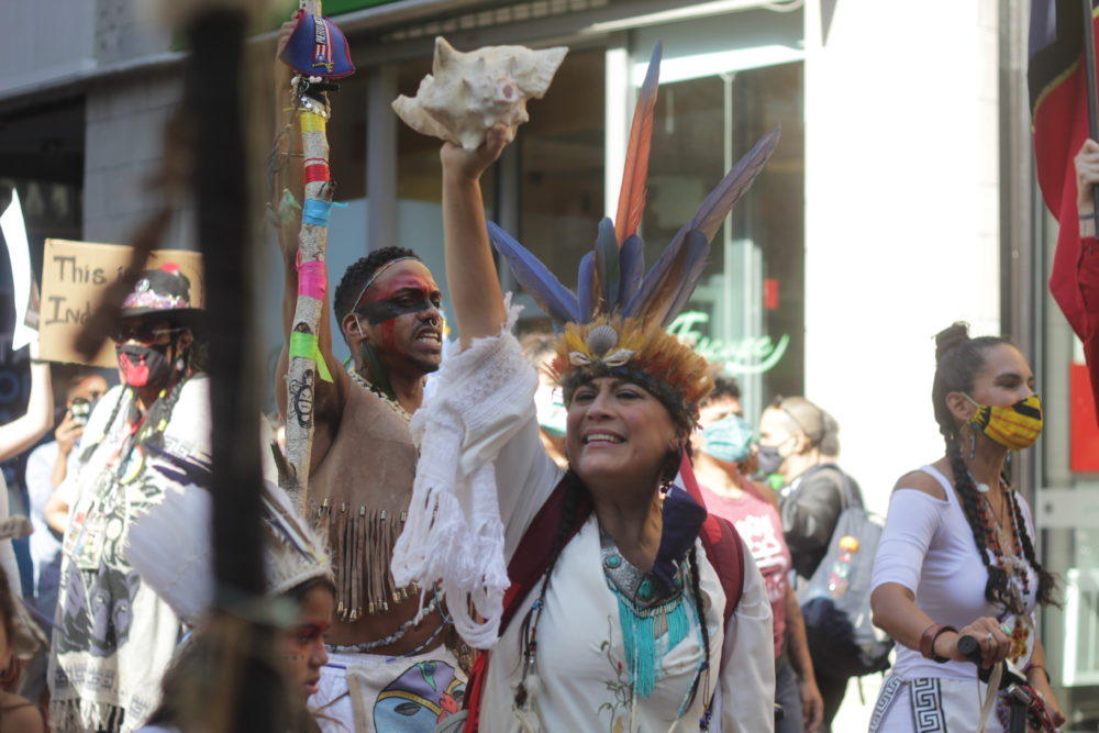 Chali'Naru Dones and other protesters call for Indigenous Peoples' Day to replace Columbus Day in Boston.