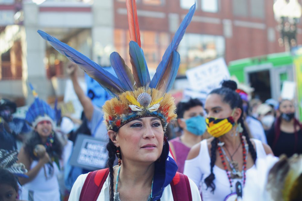 Chali'Naru Dones, a Taino woman who lives in Newton, is pictured at Saturday's rally. (Quincy Walters/WBUR)